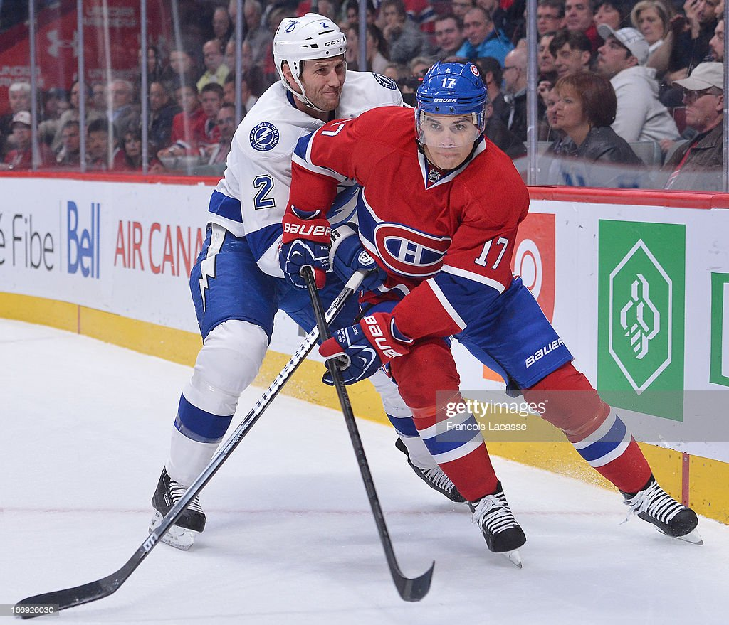 <a gi-track='captionPersonalityLinkClicked' href=/galleries/search?phrase=Rene+Bourque&family=editorial&specificpeople=685715 ng-click='$event.stopPropagation()'>Rene Bourque</a> #17 of the Montreal Canadiens battles for position against <a gi-track='captionPersonalityLinkClicked' href=/galleries/search?phrase=Eric+Brewer&family=editorial&specificpeople=202144 ng-click='$event.stopPropagation()'>Eric Brewer</a> #2 of the Tampa Bay Lightning during the NHL game on April 18, 2013 at the Bell Centre in Montreal, Quebec, Canada.