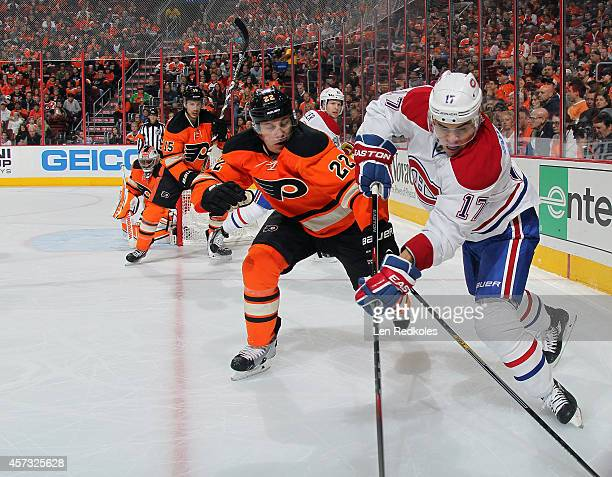 Rene Bourque of the Montreal Canadiens battles in the corner against Luke Schenn of the Philadelphia Flyers on October 11 2014 at the Wells Fargo...
