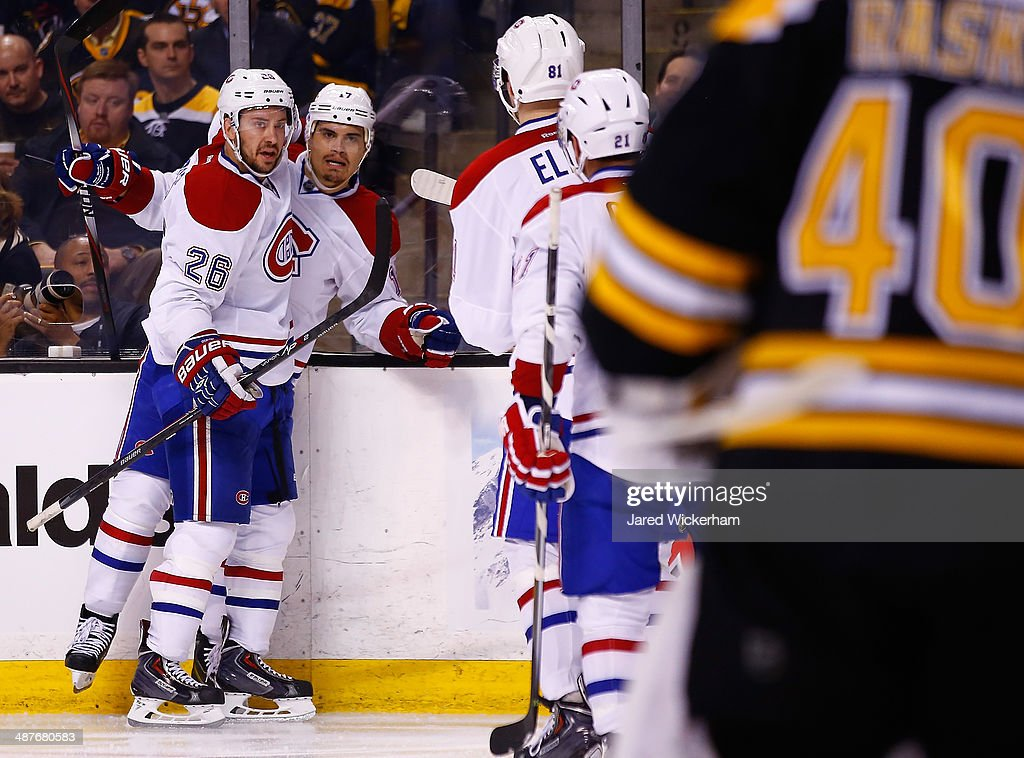 <a gi-track='captionPersonalityLinkClicked' href=/galleries/search?phrase=Rene+Bourque&family=editorial&specificpeople=685715 ng-click='$event.stopPropagation()'>Rene Bourque</a> #17 of the Montreal Canadiens celebrates after scoring past <a gi-track='captionPersonalityLinkClicked' href=/galleries/search?phrase=Tuukka+Rask&family=editorial&specificpeople=716723 ng-click='$event.stopPropagation()'>Tuukka Rask</a> #40 of the Boston Bruins in the second period in Game One of the Second Round of the 2014 NHL Stanley Cup Playoffs on May 1, 2014 in Boston, Massachusetts.