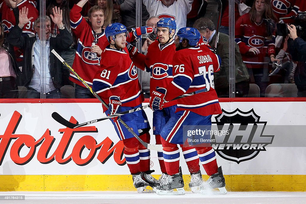 <a gi-track='captionPersonalityLinkClicked' href=/galleries/search?phrase=Rene+Bourque&family=editorial&specificpeople=685715 ng-click='$event.stopPropagation()'>Rene Bourque</a> #17 of the Montreal Canadiens celebrates his second period goal with teammates <a gi-track='captionPersonalityLinkClicked' href=/galleries/search?phrase=Lars+Eller&family=editorial&specificpeople=4324947 ng-click='$event.stopPropagation()'>Lars Eller</a> #81 and <a gi-track='captionPersonalityLinkClicked' href=/galleries/search?phrase=P.K.+Subban&family=editorial&specificpeople=714418 ng-click='$event.stopPropagation()'>P.K. Subban</a> #76 of the Montreal Canadiens against the New York Rangers in Game One of the Eastern Conference Finals of the 2014 NHL Stanley Cup Playoffs at the Bell Centre on May 17, 2014 in Montreal, Canada.