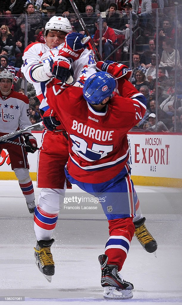<a gi-track='captionPersonalityLinkClicked' href=/galleries/search?phrase=Rene+Bourque&family=editorial&specificpeople=685715 ng-click='$event.stopPropagation()'>Rene Bourque</a> #27 of the Montreal Canadiens collides with Alex Ovechkin #8 of the Washington Capitals during the NHL game on February 4, 2012 at the Bell Centre in Montreal, Quebec, Canada.