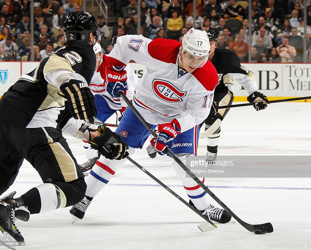 <a gi-track='captionPersonalityLinkClicked' href=/galleries/search?phrase=Rene+Bourque&family=editorial&specificpeople=685715 ng-click='$event.stopPropagation()'>Rene Bourque</a> #17 of the Montreal Canadiens controls the puck in front of <a gi-track='captionPersonalityLinkClicked' href=/galleries/search?phrase=Matt+Niskanen&family=editorial&specificpeople=2106633 ng-click='$event.stopPropagation()'>Matt Niskanen</a> #2 of the Pittsburgh Penguins on April17, 2013 at Consol Energy Center in Pittsburgh, Pennsylvania. Pittsburgh won the game 6-4.