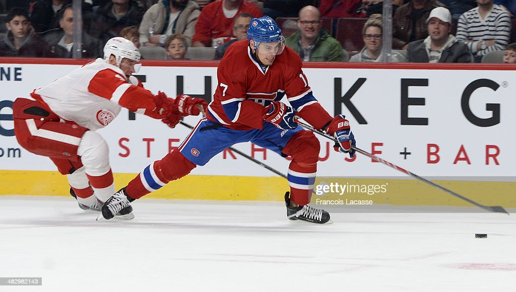 <a gi-track='captionPersonalityLinkClicked' href=/galleries/search?phrase=Rene+Bourque&family=editorial&specificpeople=685715 ng-click='$event.stopPropagation()'>Rene Bourque</a> #17 of the Montreal Canadiens controls the puck while being challenged by <a gi-track='captionPersonalityLinkClicked' href=/galleries/search?phrase=Jakub+Kindl&family=editorial&specificpeople=716743 ng-click='$event.stopPropagation()'>Jakub Kindl</a> #4 of the Detroit Red Wings during the NHL game on April 5, 2014 at the Bell Centre in Montreal, Quebec, Canada.