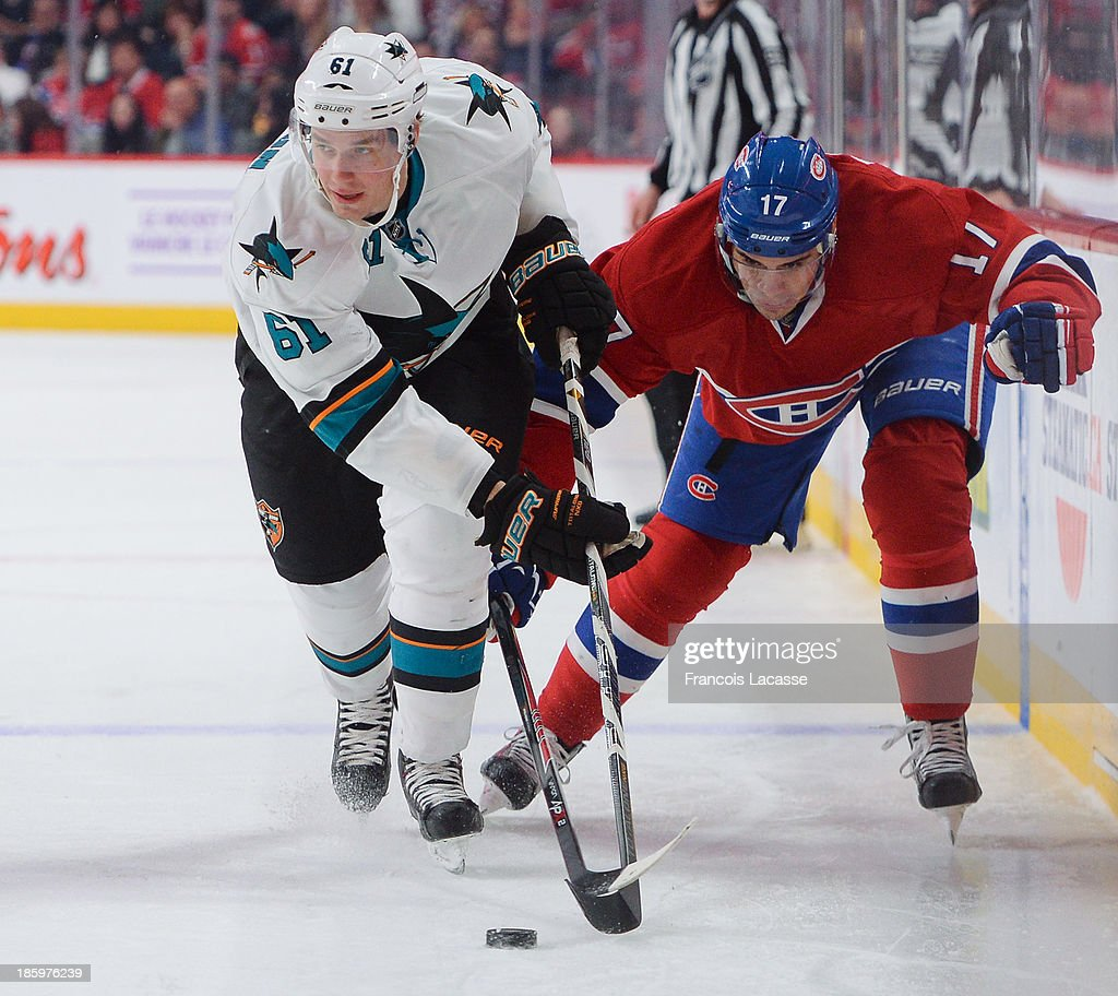 <a gi-track='captionPersonalityLinkClicked' href=/galleries/search?phrase=Rene+Bourque&family=editorial&specificpeople=685715 ng-click='$event.stopPropagation()'>Rene Bourque</a> #17 of the Montreal Canadiens fights for the puck against Justin Braun #61 of the San Jose Sharks during the NHL game on October 26, 2013 at the Bell Centre in Montreal, Quebec, Canada.