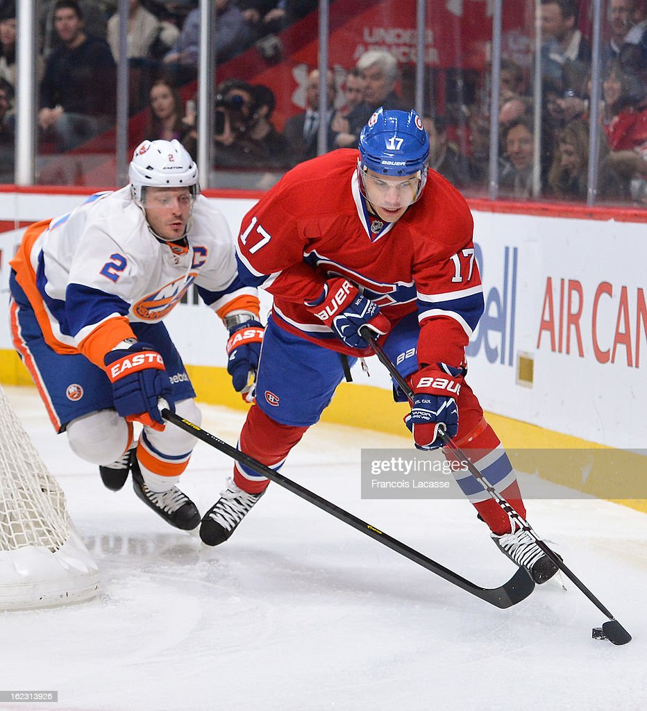 Rene Bourque #17 of the Montreal Canadiens is chased by Mark Streit #2 of the New York Islanders during the NHL game on February 21, 2013 at the Bell Centre in Montreal, Quebec, Canada.