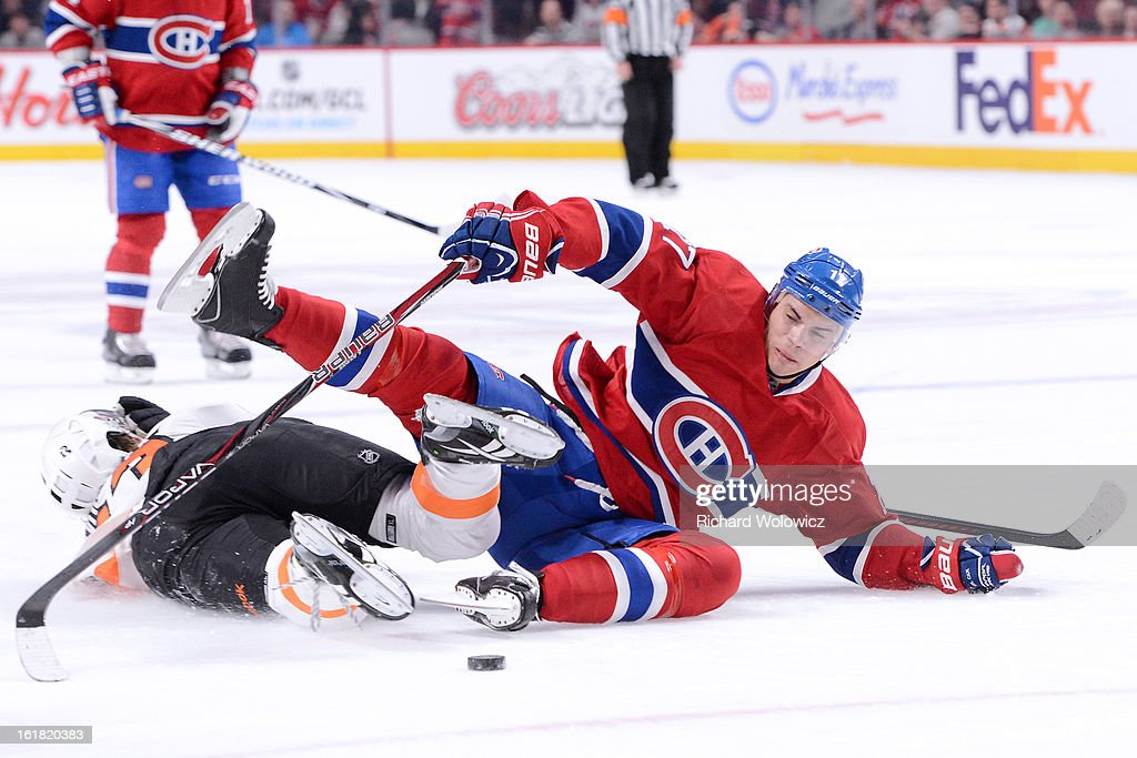<a gi-track='captionPersonalityLinkClicked' href=/galleries/search?phrase=Rene+Bourque&family=editorial&specificpeople=685715 ng-click='$event.stopPropagation()'>Rene Bourque</a> #17 of the Montreal Canadiens is taken down on a breakaway by <a gi-track='captionPersonalityLinkClicked' href=/galleries/search?phrase=Jakub+Voracek&family=editorial&specificpeople=4111797 ng-click='$event.stopPropagation()'>Jakub Voracek</a> #93 of the Philadelphia Flyers during the NHL game at the Bell Centre on February 16, 2013 in Montreal, Quebec, Canada. The Canadiens defeated the Flyers 4-1.