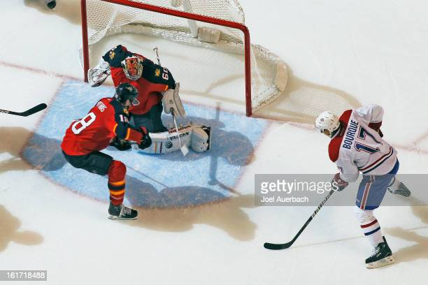 Rene Bourque of the Montreal Canadiens scores the overtime goal past goaltender Jose Theodore of the Florida Panthers at the BBT Center on February...