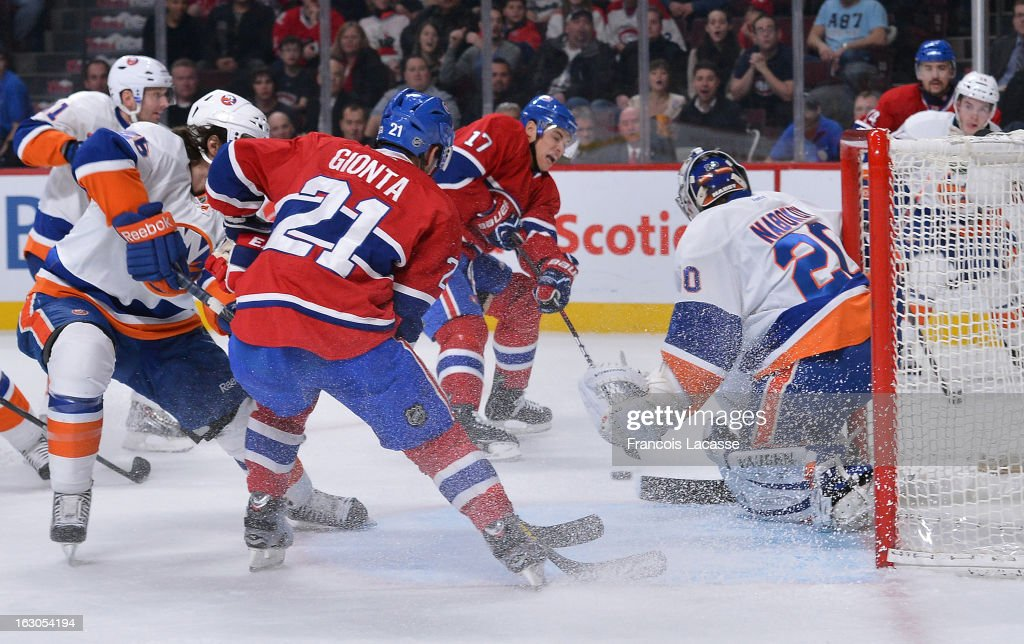 Rene Bourque #17 of the Montreal Canadiens shoots the puck past Evgeni Nabokov #20 of the New York Islanders during an NHL game on February 21, 2013 at the Bell Centre in Montreal, Quebec, Canada.
