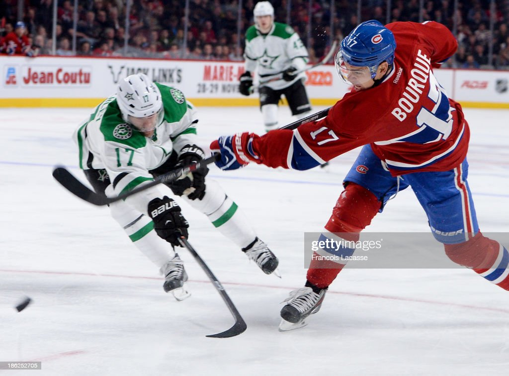 <a gi-track='captionPersonalityLinkClicked' href=/galleries/search?phrase=Rene+Bourque&family=editorial&specificpeople=685715 ng-click='$event.stopPropagation()'>Rene Bourque</a> #17 of the Montreal Canadiens slaps a shot while being challenged by <a gi-track='captionPersonalityLinkClicked' href=/galleries/search?phrase=Rich+Peverley&family=editorial&specificpeople=554442 ng-click='$event.stopPropagation()'>Rich Peverley</a> #17 of the Dallas Stars during the NHL game on October 29, 2013 at the Bell Centre in Montreal, Quebec, Canada.