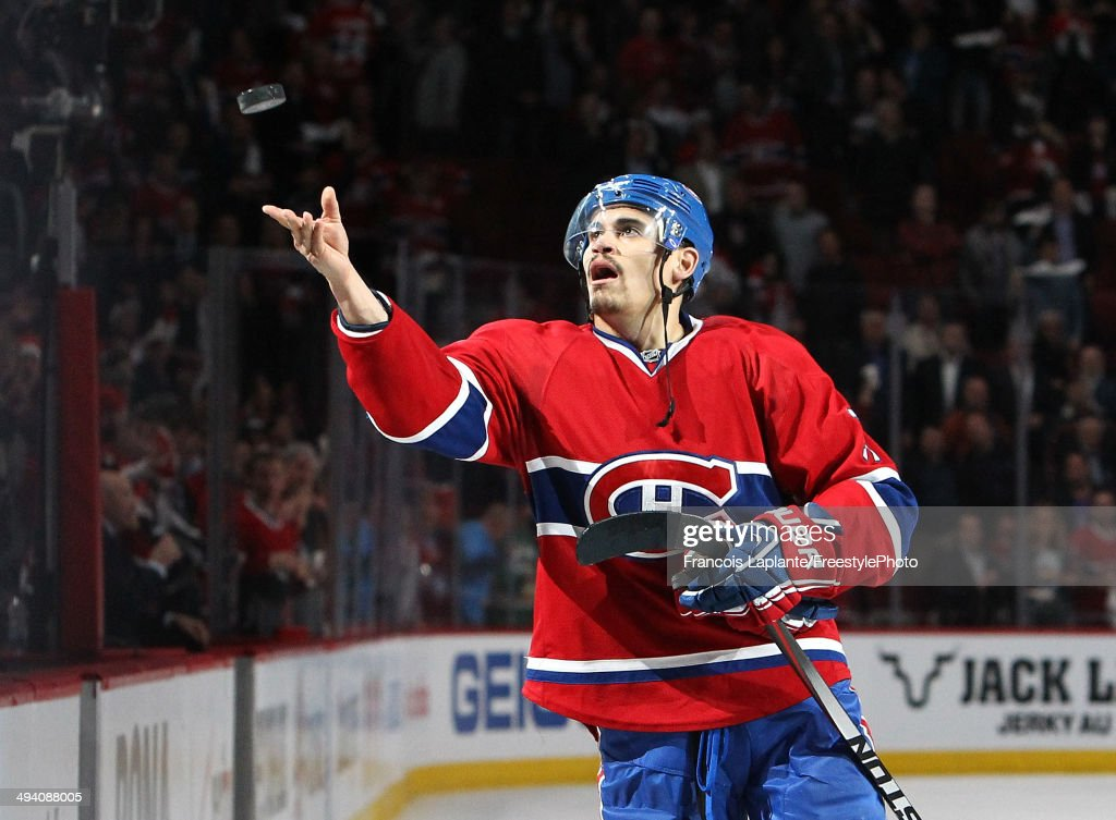 <a gi-track='captionPersonalityLinkClicked' href=/galleries/search?phrase=Rene+Bourque&family=editorial&specificpeople=685715 ng-click='$event.stopPropagation()'>Rene Bourque</a> #17 of the Montreal Canadiens throws a puck in the crowd after recieving the first star of the game against the New York Rangers during Game Five of the Eastern Conference Final in the 2014 NHL Stanley Cup Playoffs at Bell Centre on May 27, 2014 in Montreal, Canada. Canadiens defeated the Rangers 7-4.