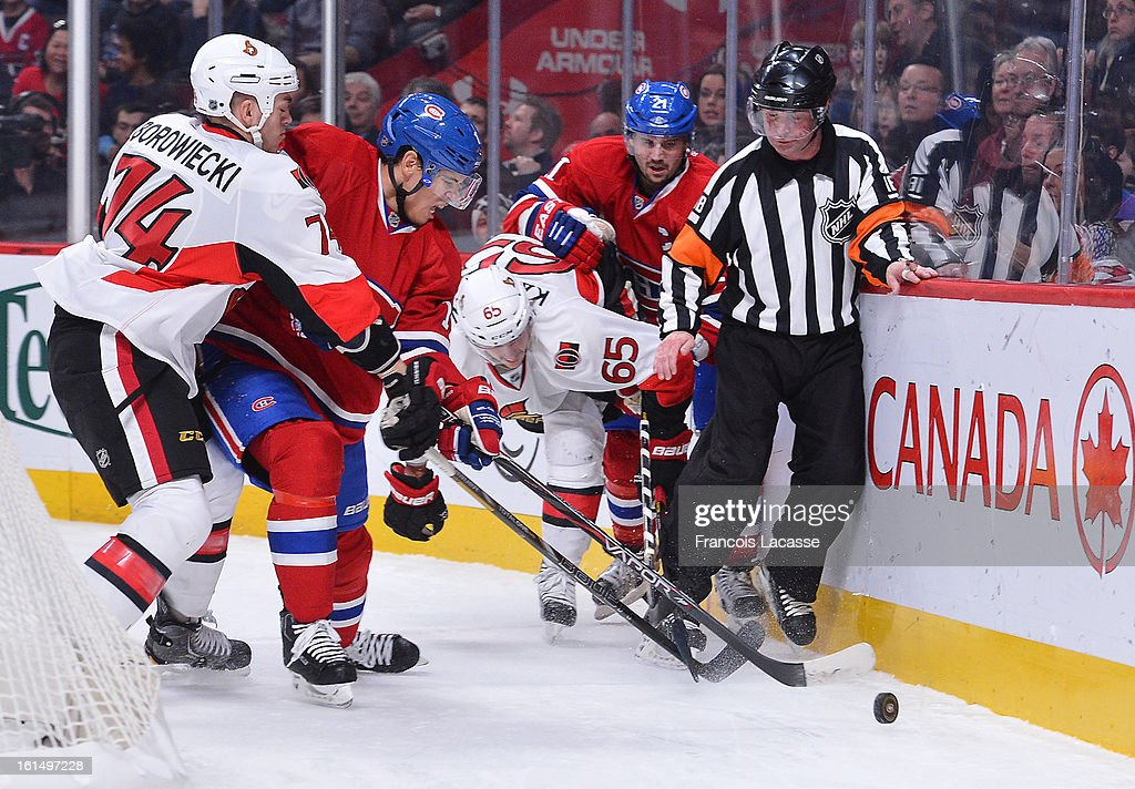 Rene Bourque #17 of the Montreal Canadiens tries to keep the puck from Mark Borowiecki #74 of the Ottawa Senators during the NHL game on February 3, 2013 at the Bell Centre in Montreal, Quebec, Canada.