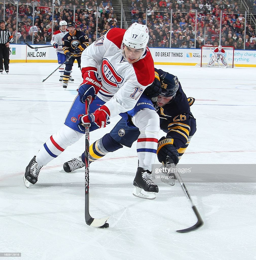 <a gi-track='captionPersonalityLinkClicked' href=/galleries/search?phrase=Rene+Bourque&family=editorial&specificpeople=685715 ng-click='$event.stopPropagation()'>Rene Bourque</a> #17 of the Montreal Canadiens tries to skate past <a gi-track='captionPersonalityLinkClicked' href=/galleries/search?phrase=Thomas+Vanek&family=editorial&specificpeople=570606 ng-click='$event.stopPropagation()'>Thomas Vanek</a> #26 of the Buffalo Sabres on February 7, 2013 at the First Niagara Center in Buffalo, New York.