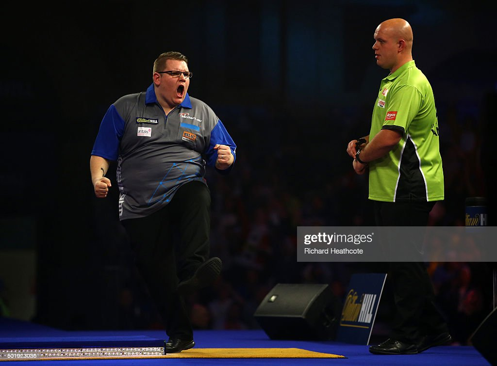 Rene Eidams celebrates winning the fourth set against <a gi-track='captionPersonalityLinkClicked' href=/galleries/search?phrase=Michael+van+Gerwen&family=editorial&specificpeople=4754172 ng-click='$event.stopPropagation()'>Michael van Gerwen</a> during their first round match on day two of the 2016 William Hill PDC World Darts Championships at Alexandra Palace on December 18, 2015 in London, England.
