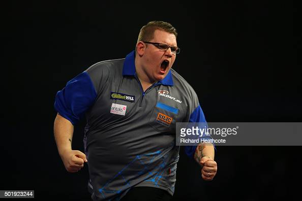 Rene Eidams reacts during his first round match against Michael van Gerwen on day two of the 2016 William Hill PDC World Darts Championships at...