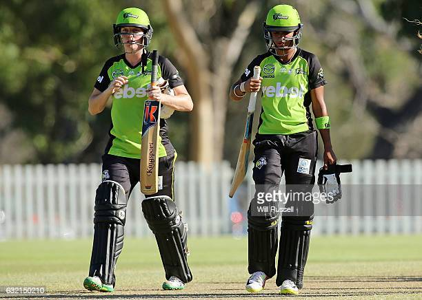 Rene Farrell and Harmanpreet Kaur of the Thunder leave the field after the teams defeat during the Women's Big Bash League match between the Perth...