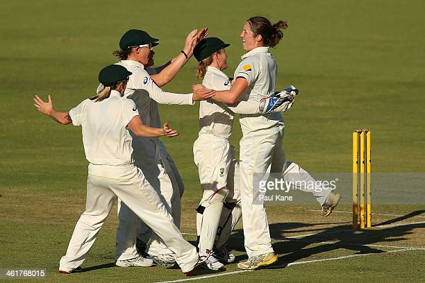 Rene Farrell of Australia celebrates the wicket of Sarah Taylor of England during day two of the Women's Ashes Test match between Australia and...