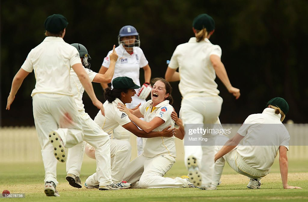 Rene Farrell (C) of Australia celebrates with <a gi-track='captionPersonalityLinkClicked' href=/galleries/search?phrase=Lisa+Sthalekar&family=editorial&specificpeople=178307 ng-click='$event.stopPropagation()'>Lisa Sthalekar</a> (L) and other team mates after taking a hat-trick with the wicket of Danielle Hazell of England during day three of the Test match between the Australia and England at Bankstown Oval on January 24, 2011 in Sydney, Australia.