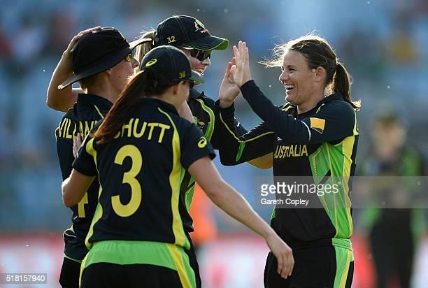 Rene Farrell of Australia celebrates with teammates after dismissing Heather Knight fo England during the Women's ICC World Twenty20 India 2016 Semi...