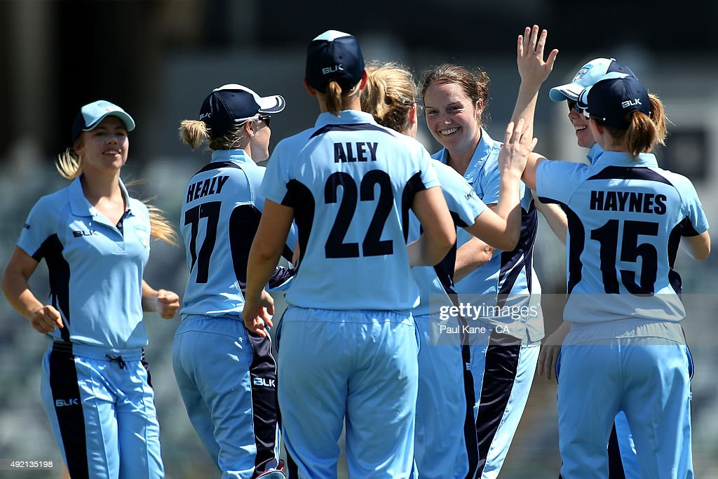 Rene Farrell of New South Wales celebrates with team mates after dismissing Tegan McPharlin of South Australia during the round one WNCL match...