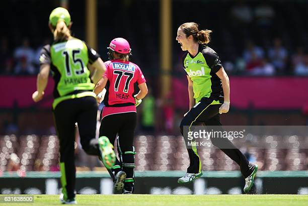 Rene Farrell of the Thunder celebrates taking the wicket of Alyssa Healy of the Sixers during the Women's Big Bash League match between the Sydney...
