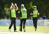 Rene Farrell of the Thunder celebrates with team mates after taking the wicket of Lisa Sthalekar of the Sixers during the Women's Big Bash League...