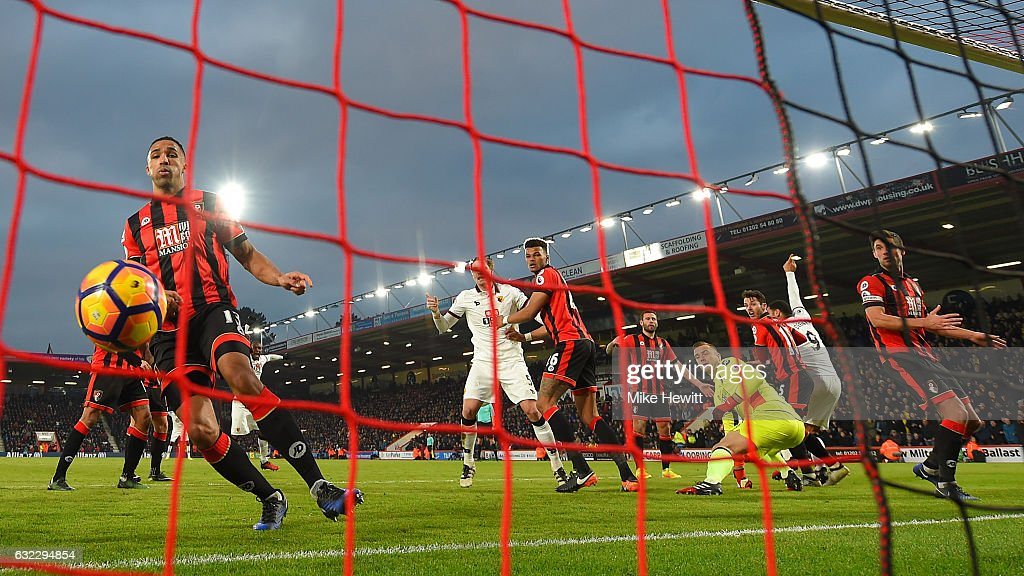 Rene Gilmartin of Watford (L) can only watch as a header from Troy Deeney of Watford (no9) crosses the line during the Premier League match between AFC Bournemouth and Watford at Vitality Stadium on January 21, 2017 in Bournemouth, England.