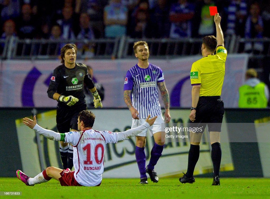 <a gi-track='captionPersonalityLinkClicked' href=/galleries/search?phrase=Rene+Klingbeil&family=editorial&specificpeople=639899 ng-click='$event.stopPropagation()'>Rene Klingbeil</a> of Aue receives the red card from referee Felix Zwayer during the Second Bundesliga match between Erzgebirge Aue and 1. FC Kaiserslautern at Erzgebirgs Stadium on April 15, 2013 in Aue, Germany.