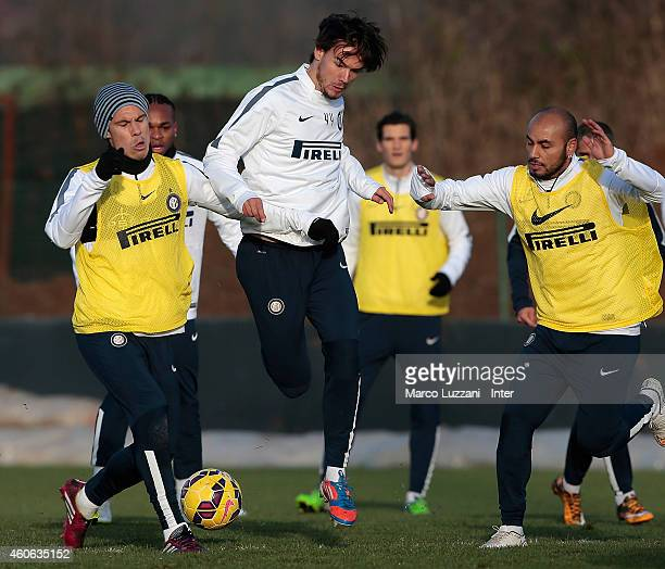 Rene Krhin competes with Anderson Hernanes and Cicero Moreira Jonathan during FC Internazionale training session at the club's training ground on...