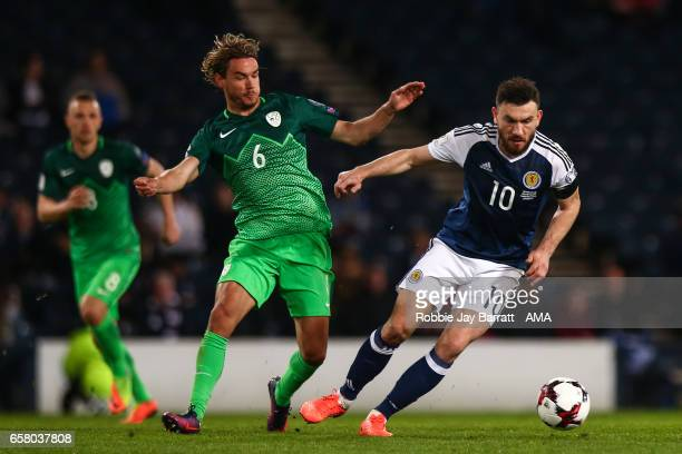 Rene Krhin of Slovenia and Robert Snodgrass of Scotland during the FIFA 2018 World Cup Qualifier between Scotland and Slovenia at Hampden Park on...