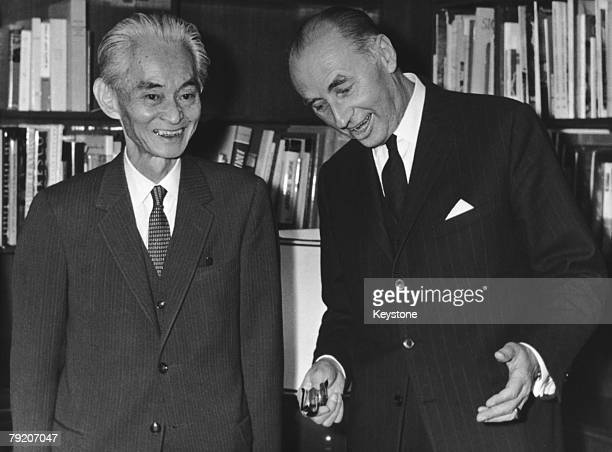 Rene Maheu DirectorGeneral of UNESCO welcomes Japanese author Yasunari Kawabata winner of that year's Nobel Prize for Literature to Paris 18th...