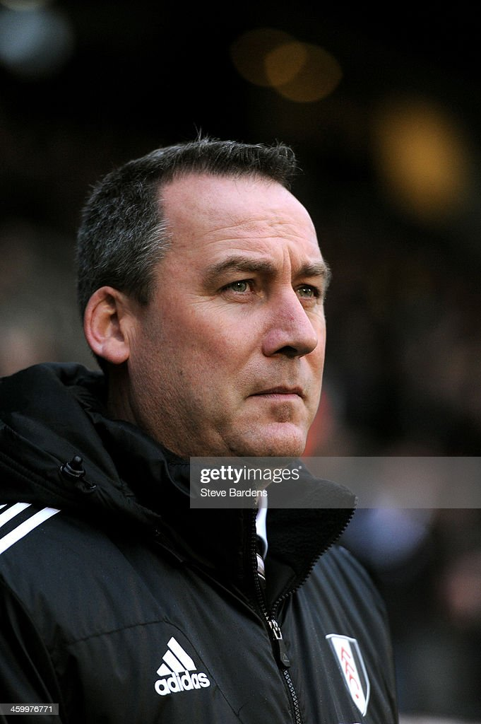 <a gi-track='captionPersonalityLinkClicked' href=/galleries/search?phrase=Rene+Meulensteen&family=editorial&specificpeople=554528 ng-click='$event.stopPropagation()'>Rene Meulensteen</a> the Fulham manager looks on during the Barclays Premier League match between Fulham and West Ham United at Craven Cottage on January 1, 2014 in London, England.