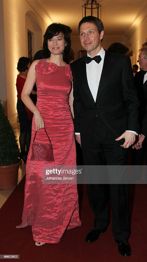 Rene Obermann (R) and Maybrit Illner arrive for the Hubert Burda Birthday Reception at Munich royal palace on February 12, 2010 in Munich, Germany.