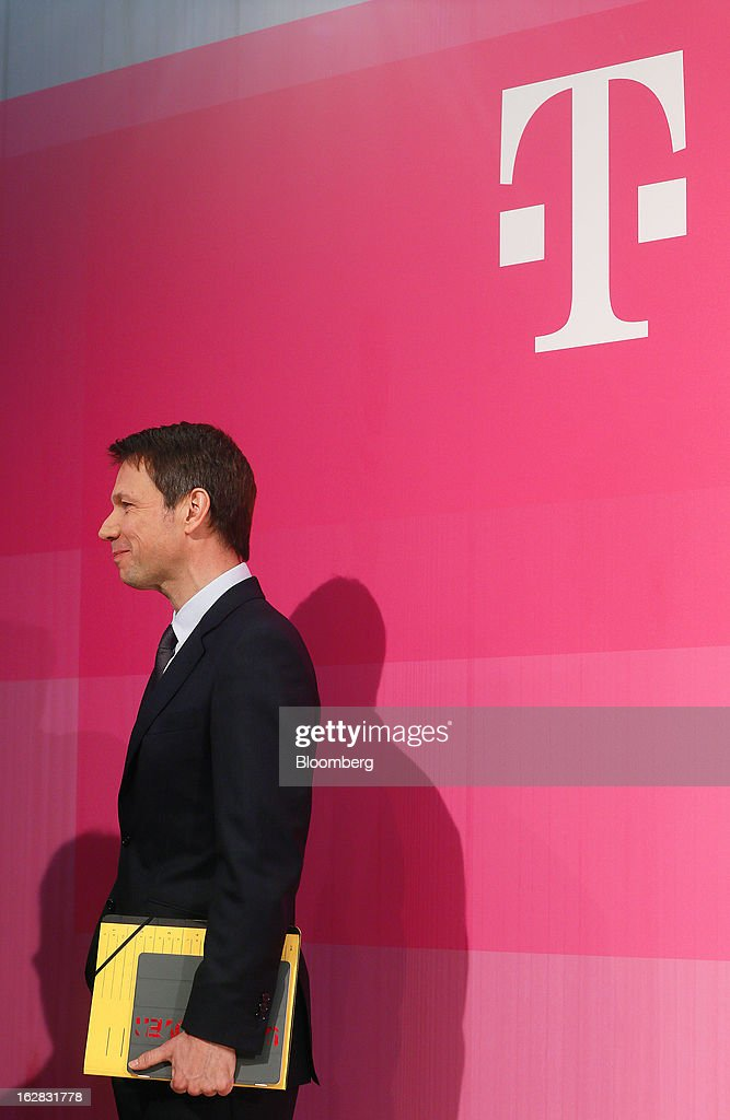 <a gi-track='captionPersonalityLinkClicked' href=/galleries/search?phrase=Rene+Obermann&family=editorial&specificpeople=655349 ng-click='$event.stopPropagation()'>Rene Obermann</a>, chief executive officer of Deutsche Telekom AG, smiles before leaving a news conference in Bonn, Germany, on Thursday, Feb. 28, 2013. Deutsche Telekom AG, Germany's largest telephone company, reported fourth-quarter earnings before some items that missed analysts' estimates because of higher spending to add customers in Germany and retain mobile- phone subscriptions in the U.S. Photographer: Ralph Orlowski/Bloomberg via Getty Images