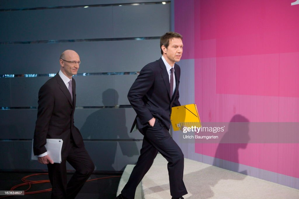 Rene Obermann (right), current CEO, and Timotheus Hoettges (left), designated CEO and current financial chairman of the Deutsche Telekom AG, before the annual press conference to announce the 2012 financial results on February 28, 2013 in Bonn, Germany. Deutsche Telekom announced a net loss of 5.25 billion euros for 2012, primarily due to merger-related writedowns in the United States. Chief Executive Rene Obermann also announced that, in spite of the decline in underlying profits, targets had been met for 2012 with stable revenues, allowing the company to maintain its planned dividend.