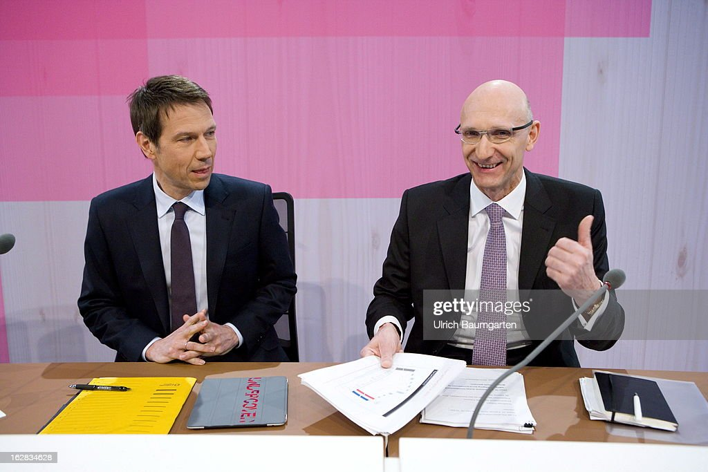 Rene Obermann (left), current CEO, and Timotheus Hoettges (right), designated CEO and current financial chairman of the Deutsche Telekom AG, before the annual press conference to announce the 2012 financial results on February 28, 2013 in Bonn, Germany. Deutsche Telekom announced a net loss of 5.25 billion euros for 2012, primarily due to merger-related writedowns in the United States. Chief Executive Rene Obermann also announced that, in spite of the decline in underlying profits, targets had been met for 2012 with stable revenues, allowing the company to maintain its planned dividend.
