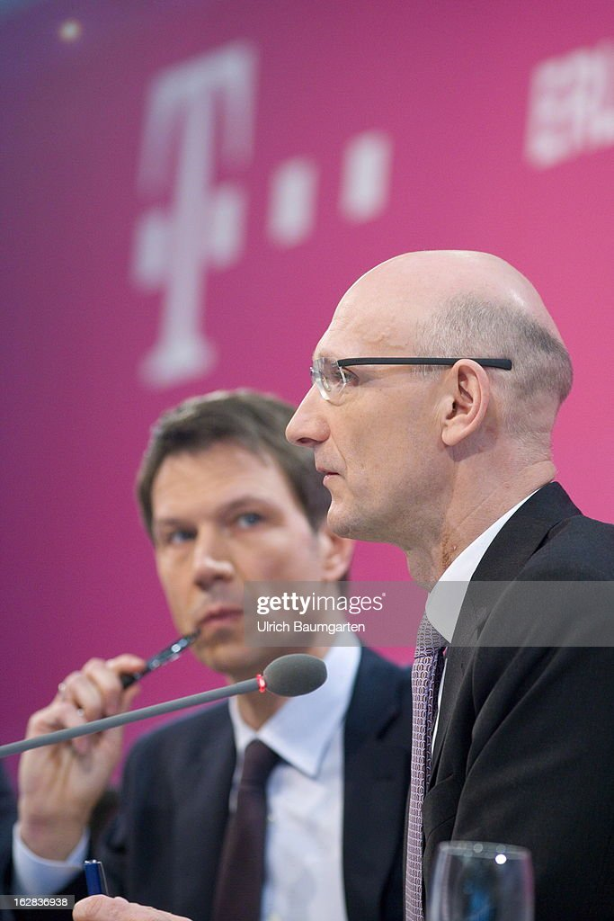 Rene Obermann (left), current CEO, and Timotheus Hoettges (right), designated CEO and current financial chairman of the Deutsche Telekom AG, during the annual press conference to announce the 2012 financial results on February 28, 2013 in Bonn, Germany. Deutsche Telekom announced a net loss of 5.25 billion euros for 2012, primarily due to merger-related writedowns in the United States. Chief Executive Rene Obermann also announced that, in spite of the decline in underlying profits, targets had been met for 2012 with stable revenues, allowing the company to maintain its planned dividend.