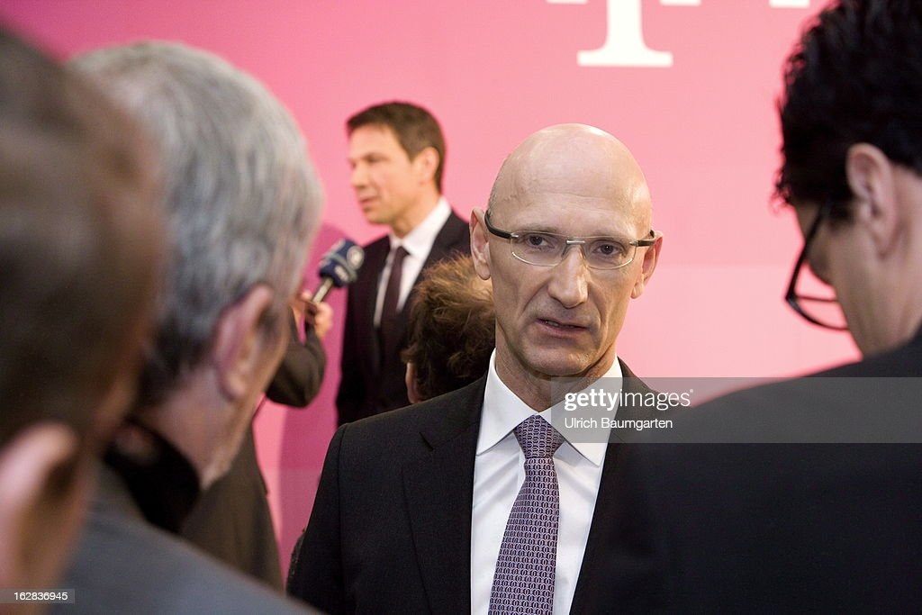Rene Obermann (back), current CEO, and Timotheus Hoettges (front), designated CEO and current financial chairman of the Deutsche Telekom AG, after the annual press conference to announce the 2012 financial results on February 28, 2013 in Bonn, Germany. Deutsche Telekom announced a net loss of 5.25 billion euros for 2012, primarily due to merger-related writedowns in the United States. Chief Executive Rene Obermann also announced that, in spite of the decline in underlying profits, targets had been met for 2012 with stable revenues, allowing the company to maintain its planned dividend.