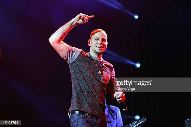 Rene of Calle 13 performs with Draco Rosa at Draco Friends Concert at Coliseo de Puerto Rico on December 6 2013 in San Juan Puerto Rico