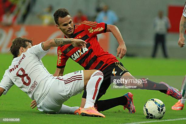 Rene of Sport Recife battles for the ball with Diguinho of Fluminense during the Brasileirao Series A 2014 match between Sport Recife and Fluminense...