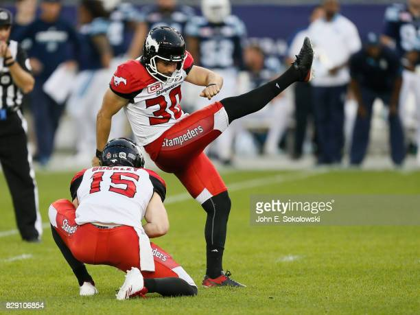 Rene Paredes of the Calgary Stampeders kicks a convert against the Toronto Argonauts during a CFL game at BMO Field on August 3 2017 in Toronto...