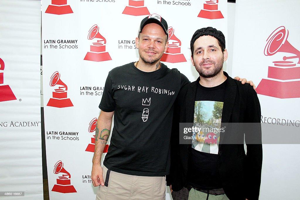 Rene Perez and Eduardo Cabra of Calle 13 attend 'Latin GRAMMY In The Schools' at Escuela Especializada en Bellas Artes Pablo Casals on April 24, 2014 in Bayamon, Puerto Rico.