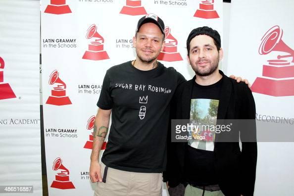 Rene Perez and Eduardo Cabra of Calle 13 attend 'Latin GRAMMY In The Schools' at Escuela Especializada en Bellas Artes Pablo Casals on April 24 2014...