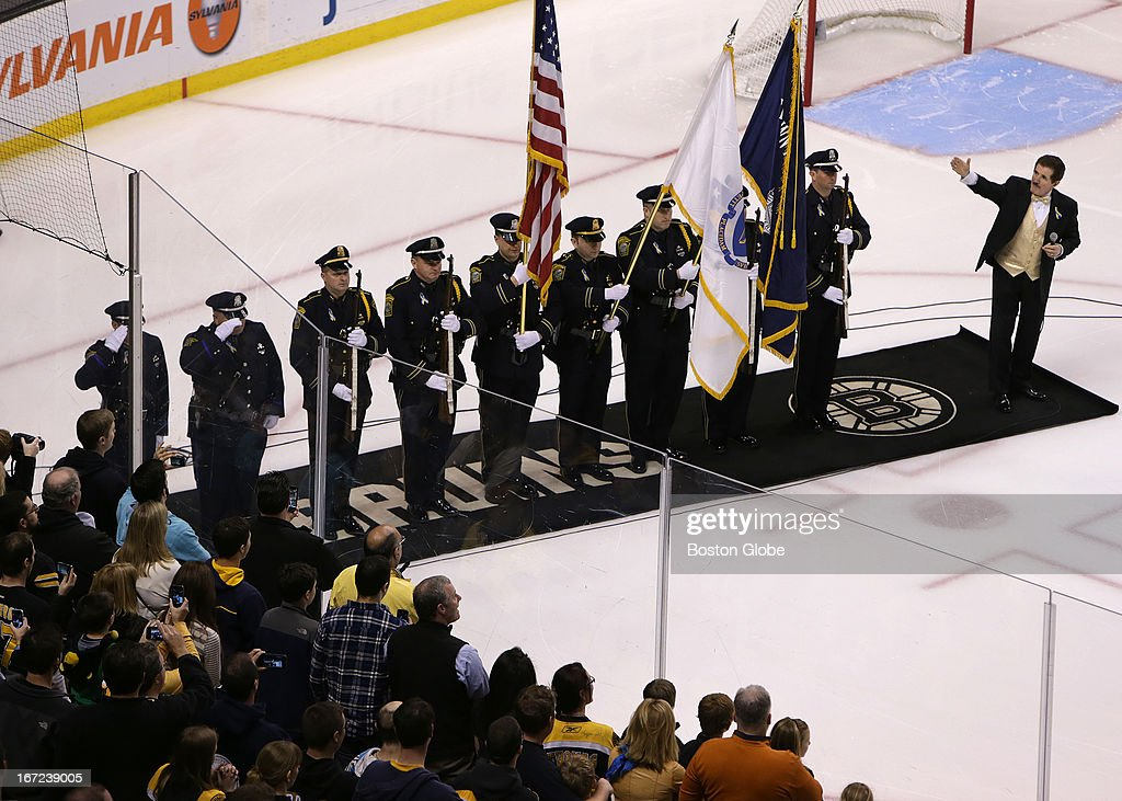 Rene Rancourt salutes the Watertown Police Honor Guard during the playing of the National Anthem at the start of today's game between the Boston Bruins and the Florida Panthers. The Boston Bruins take on the Florida Panthers at TD Garden.