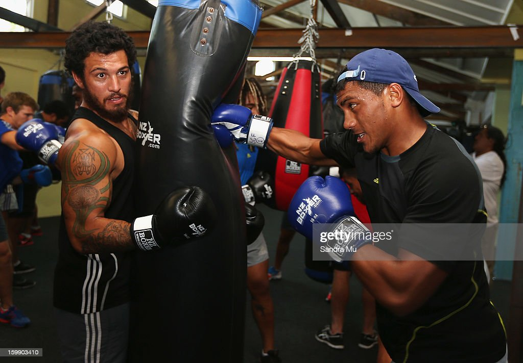 Rene Ranger (L) hold the bag for Charles Piutau during a Blues training session with Shane Cameron at Shane Cameron Fitness on January 23, 2013 in Auckland, New Zealand.