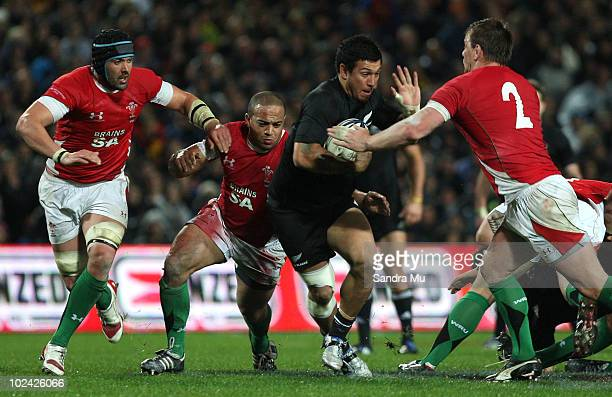 Rene Ranger of New Zealand looks to fend off Matthew Rees of Wales during the test match between the New Zealand All Blacks and Wales at Waikato...