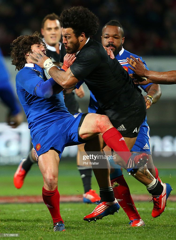 Rene Ranger of the All Blacks is tackled by Yoann Huget of France during the Third Test Match between the New Zealand All Blacks and France at Yarrow Stadium on June 22, 2013 in New Plymouth, New Zealand.