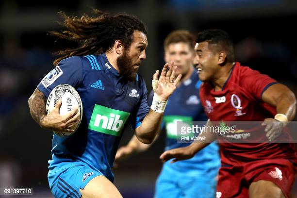 Rene Ranger of the Blues heads in for the opening try during the round 15 Super Rugby match between the Blues and the Reds at Apia Park National...