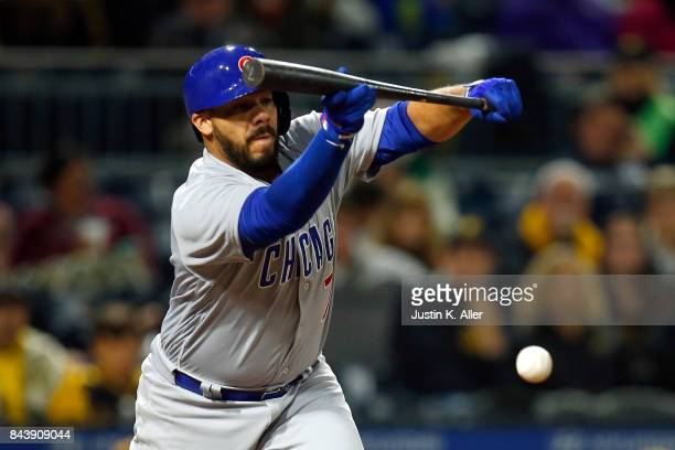 Rene Rivera of the Chicago Cubs lays down a sacrifice bunt scoring a run in the second inning against the Pittsburgh Pirates at PNC Park on September...
