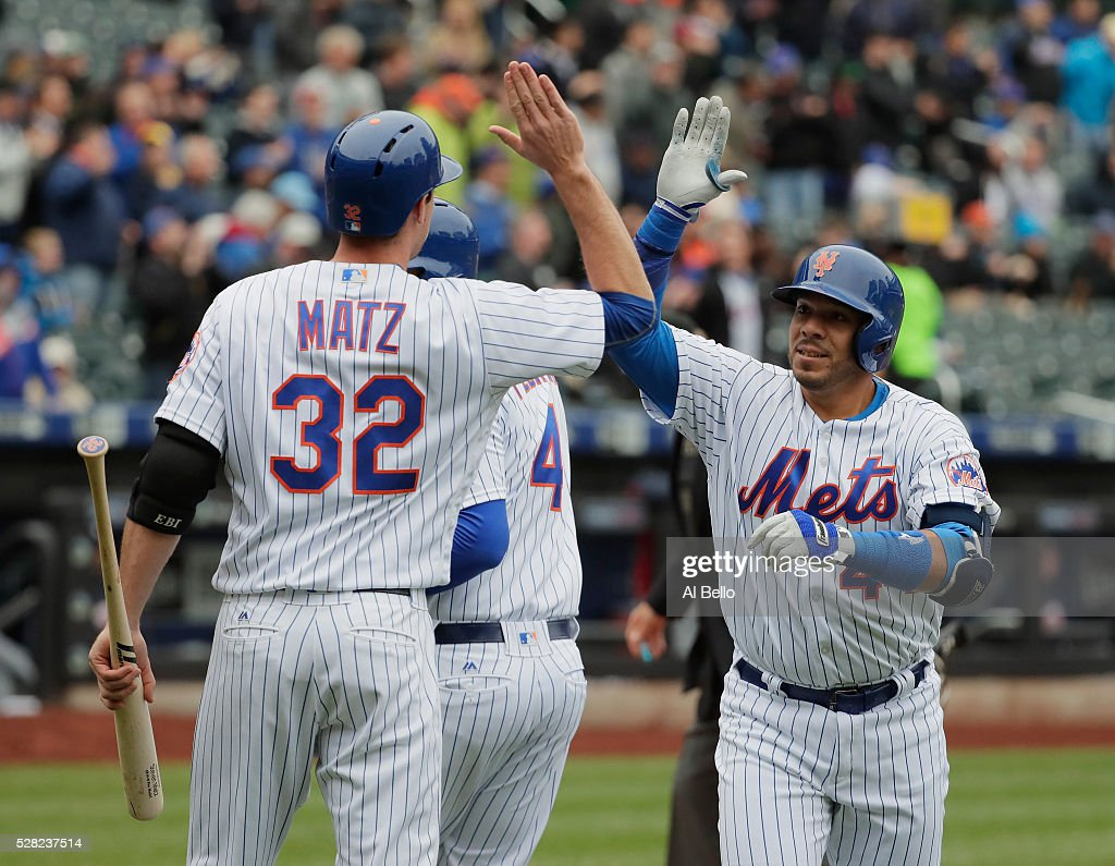 <a gi-track='captionPersonalityLinkClicked' href=/galleries/search?phrase=Rene+Rivera&family=editorial&specificpeople=234850 ng-click='$event.stopPropagation()'>Rene Rivera</a> #44 of the New York Mets celebrates a second inning two run home run with <a gi-track='captionPersonalityLinkClicked' href=/galleries/search?phrase=Wilmer+Flores&family=editorial&specificpeople=5970686 ng-click='$event.stopPropagation()'>Wilmer Flores</a> #4 and <a gi-track='captionPersonalityLinkClicked' href=/galleries/search?phrase=Steven+Matz&family=editorial&specificpeople=12510614 ng-click='$event.stopPropagation()'>Steven Matz</a> against the Atlanta Braves during their game at Citi Field on May 4, 2016 in New York City.