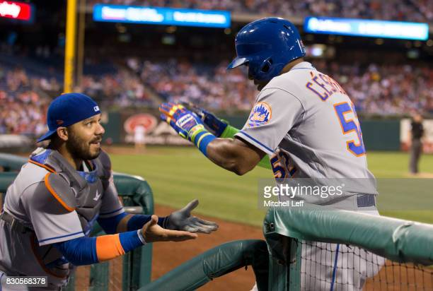 Rene Rivera of the New York Mets celebrates with Yoenis Cespedes after Cespedes hit a three run home run in the top of the third inning against the...